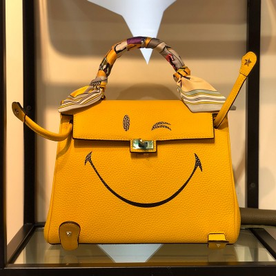Hermes Kelly Smiling Bag Togo Leather Gold Hardware In Yellow